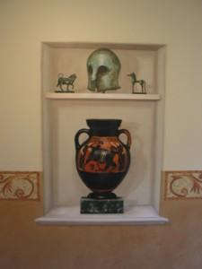 painted greek antiquities in a trompe l'oeil niche.